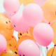 A bouquet of balloons with frowning and smiling faces