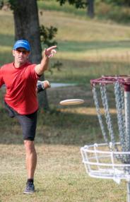 A man throws a frisbee in a Joplin park