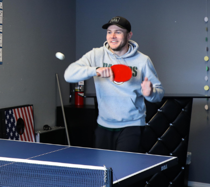 A man playing ping pong at the office