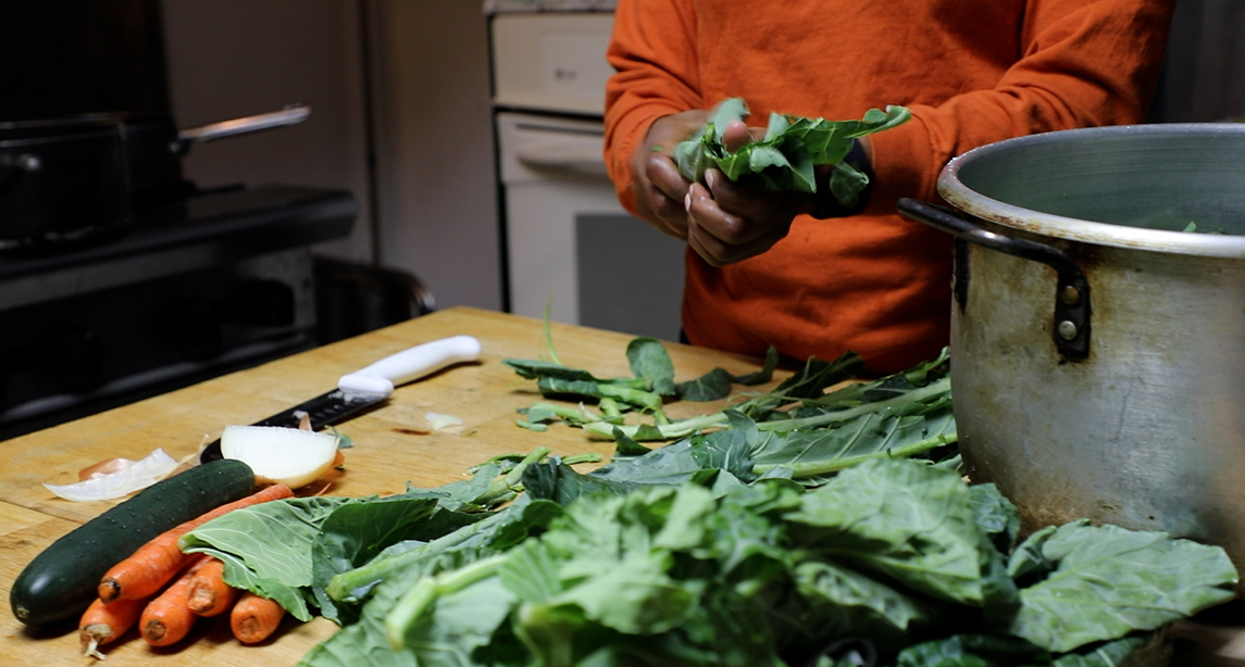 A meal with lettuce and carrots being prepared