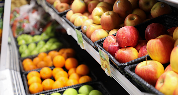 A produce section filled with apples
