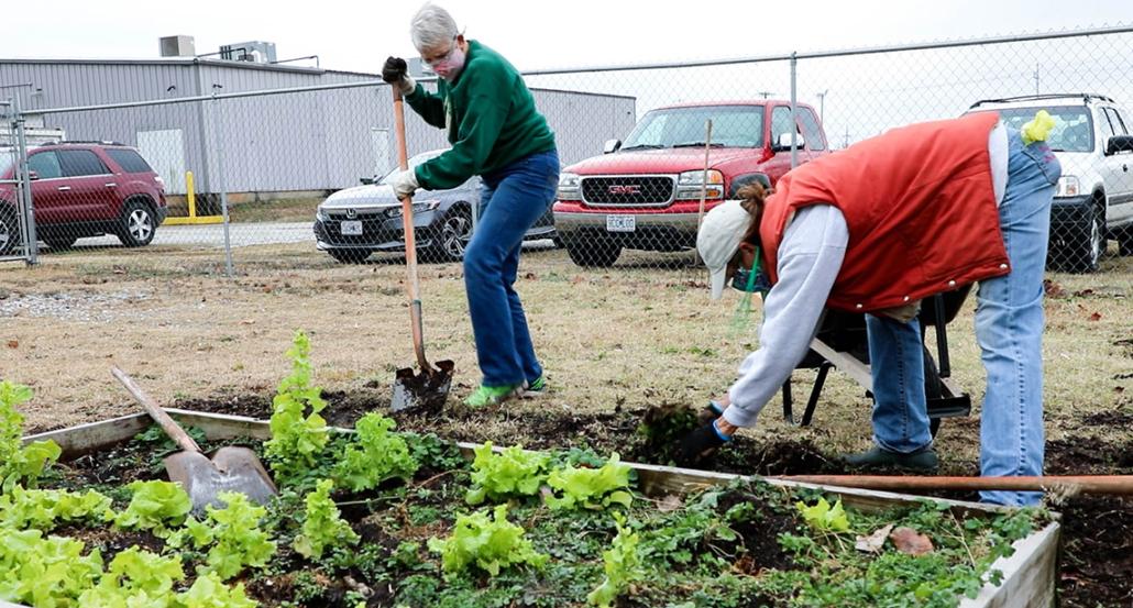 Volunteers tend to the Joplin Community Garden